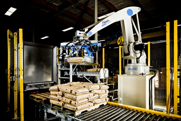 Image of a Columbia Okura Robotic Palletizer stacking bags.
