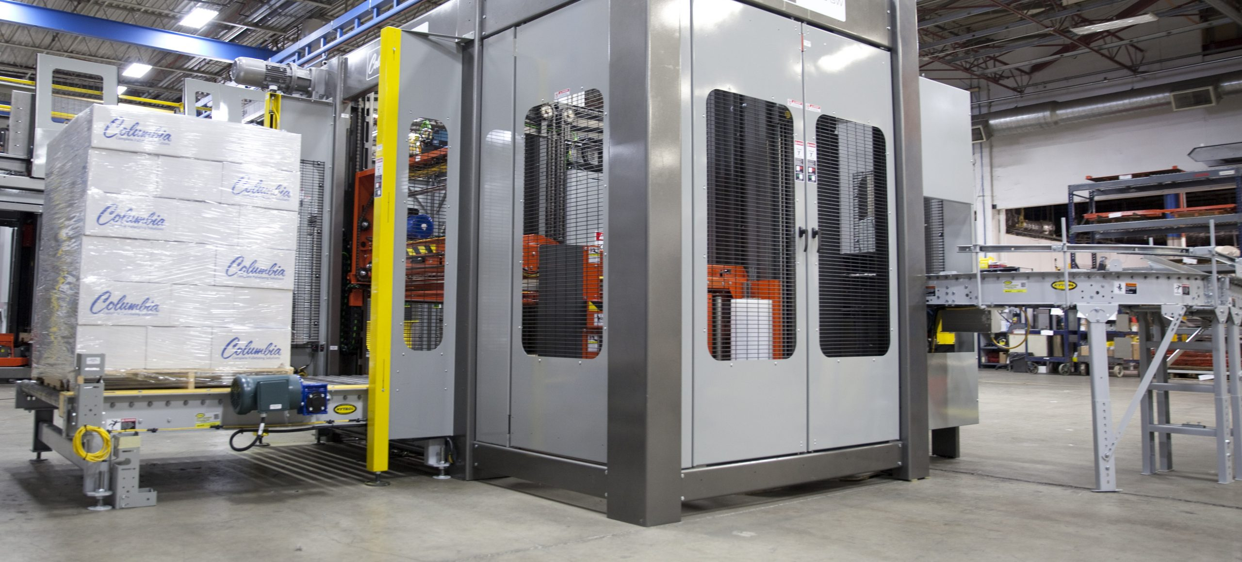 Image of a FL1000 floor level palletizer with Stretch Wrapper.