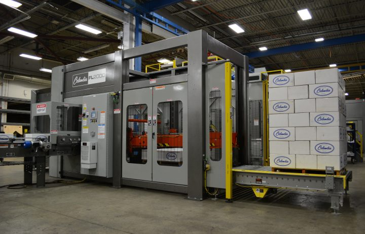 Image of a FL2000 floor level palletizer with a full pallet load of Columbia demo cases.